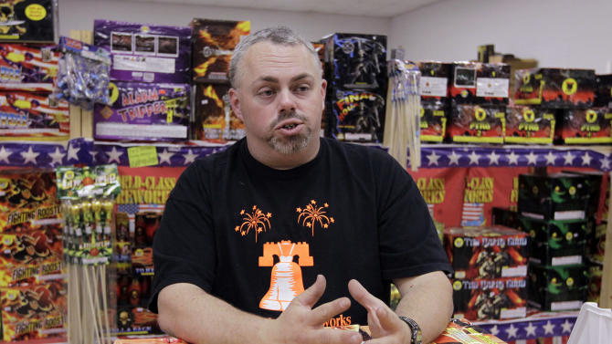 In this Thursday, June 28, 2012 photo, Paul Forman, owner of Independence Fireworks and Forman Blasters Pyrotechnics in Peru, Ind., talks about the fireworks ban in his county, in Peru, Ind. Forman says he understands the safety concerns but says his countyís decision to declare a disaster emergency has devastated his business. Four customers had already called off fireworks shows this week, and he anticipated more cancellations before the holiday. He said his business had dropped from around 50 customers a day to a total of 11 since the ban went into effect June 25. (AP Photo/Michael Conroy)