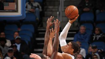 Big 1st half helps Memphis coast past Magic 108-82