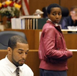 Banika Jones looks at D'Andre Lane as she gets ready to testify against D'Andre Lane  before Judge Vonda R. Evans at Frank Murphy Hall of Justice in Detroit on Wednesday, Sept. 19, 2012.  D'Andre Lane is accused of beating his 2-year old daughter Bianca Jones to death with a stick with a towel wrapped in duct tape, and disposing of her body. (AP Photo/Detroit News, David Coates)  DETROIT FREE PRESS OUT; HUFFINGTON POST OUT