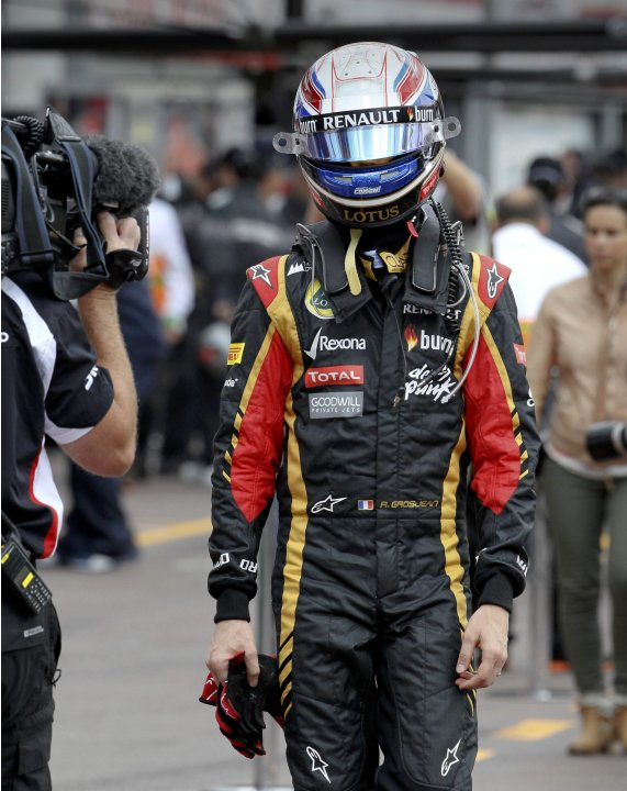 Lotus Formula One driver Romain Grosjean of France returns to the pit after a crash during the third practice session of the Monaco F1 Grand Prix