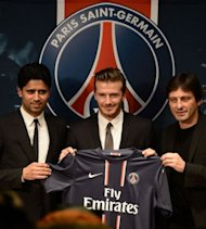 <p>Former England captain David Beckham (C) poses with his new jersey as he gives a press conference flanked by PSG Qatari president Nasser Al-Khelaifi (L) and PSG sports director Leonardo at the Parc des Princes stadium in Paris, on January 31, 2013. Beckham on January 31 signed a five-month deal with the Ligue 1 leaders until the end of June.</p>