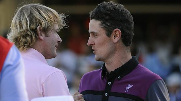 Justin Rose of Britain (R) congratulates Brandt Snedeker of the U.S. as Snedeker wins the Tour Championship golf tournament and the FedExCup at the East Lake Golf Club in Atlanta, Georgia (Reuters)