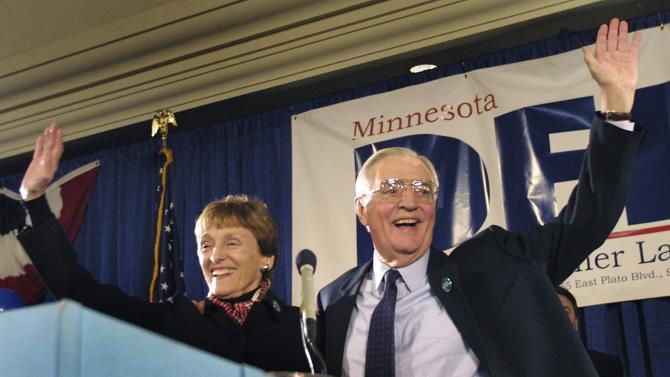 Democratic Senate candidate and former Vice President Walter Mondale and his wife Joan wave to supporters in St.Paul, Minnesota
