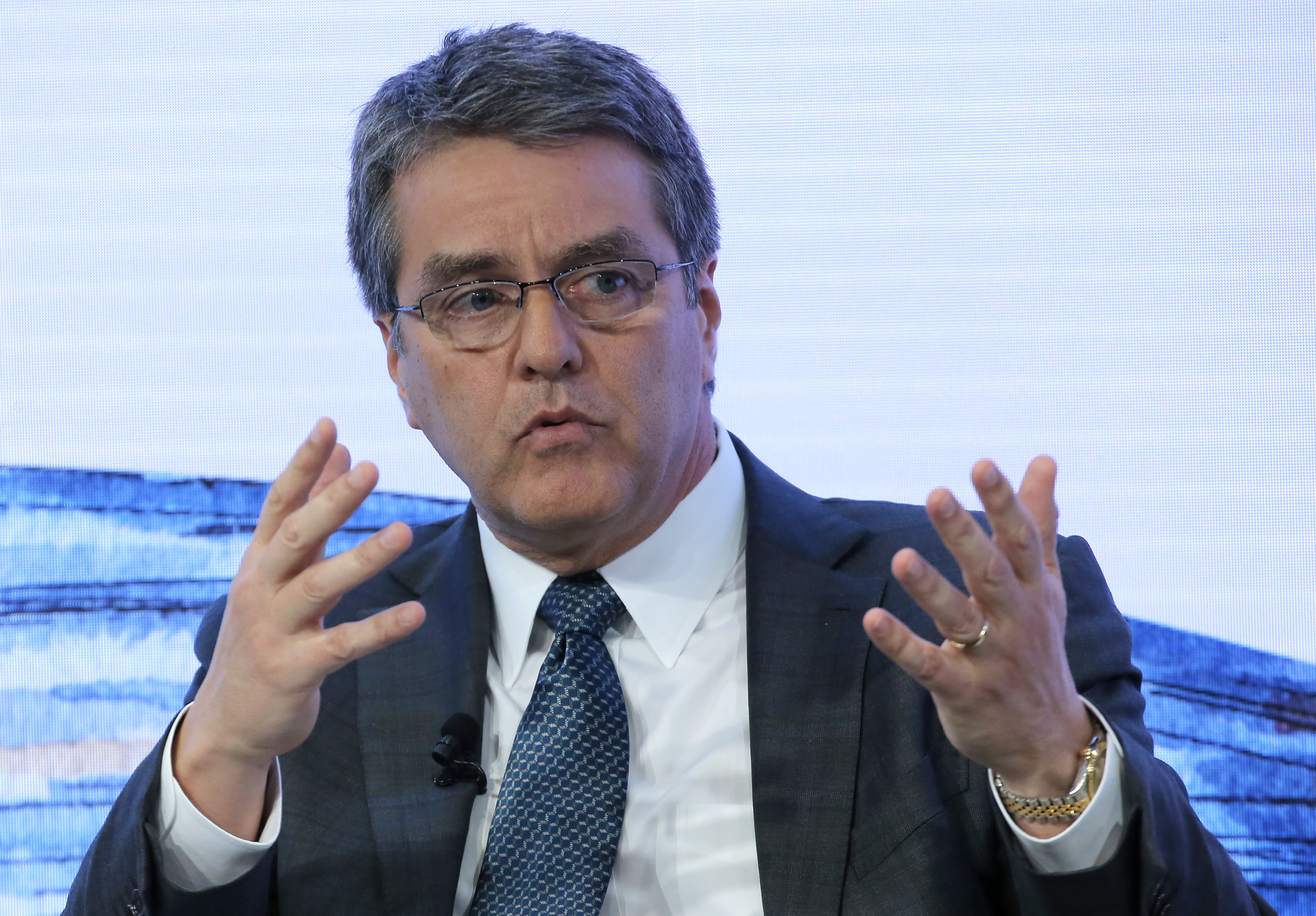 The Latest: WTO chief frets over trade war talk