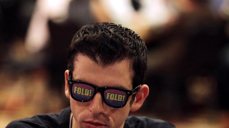 In this photo taken Saturday, Jan. 19, 2013, Jared Lerner of New York University plays poker during the MBA Poker Championship and Recruitment Weekend at Planet Hollywood in Las Vegas.(AP Photo/Las Vegas Sun, Leila Navidi)
