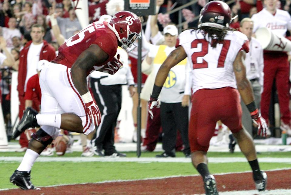 No. 1 Alabama steamrolls struggling Arkansas, 52-0