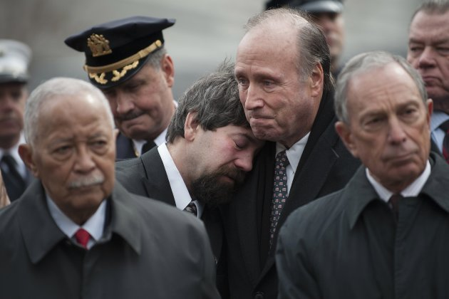Stephen Knapp is comforted by Charles Maikish, former World Trade Center Director, as mourners and family members of victims participate in a 20th anniversary memorial for victims of the 1993 bombing
