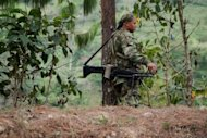 A member of the Revolutionary Armed Forces of Colombia (FARC) rebel group mans a checkpoint near Toribio, department of Cauca, Colombia, on July 11. The United States, a long-time ally of the Colombian government in its fight against drug trafficking, a major source of funding for the rebels, Wednesday voiced &quot;full support&quot; for the peace process
