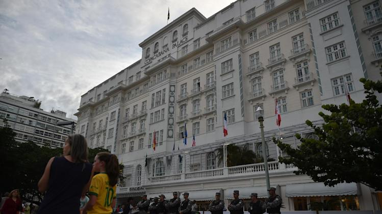 Security personnel stand guard outside the Copacabana Hotel following the arrest of Ray Whelan, a director of Match Hospitality, over illegal tickets in Rio de Janeiro on July 7, 2014