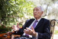 Israel's President Shimon Peres speaks during an interview with Reuters at his residence in Jerusalem June 16, 2013. REUTERS/Baz Ratner