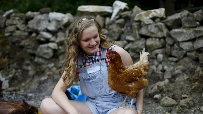 Charlotte Gibson waits to race her hen Blossom during the World Championship Hen Racing Championships in Bonsall