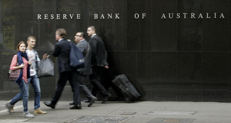 Australian central bank cuts rate to record low