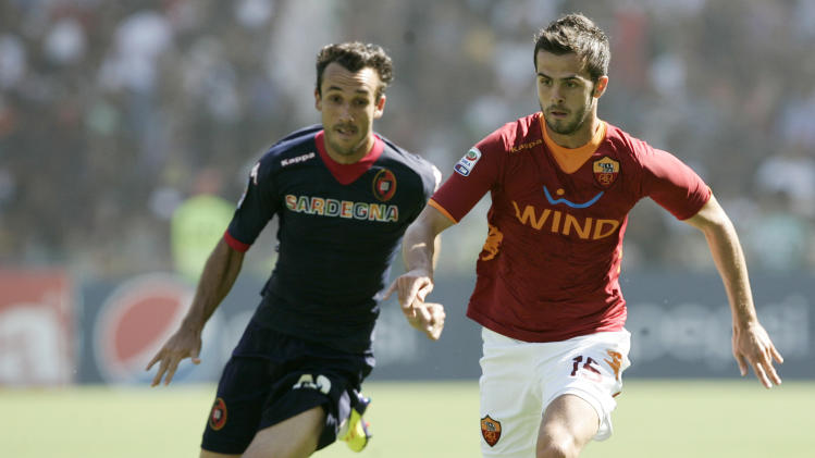 AS Roma midfielder Miralem Pjanic, of Bosnia, right, is chased by Cagliari forward Thiago Ribeiro Cardoso, of Brazil, during a Serie A soccer match between AS Roma and Cagliari, at Rome's Olympic stadium, Sunday, Sept. 11, 2011. (AP Photo/Riccardo De Luca)