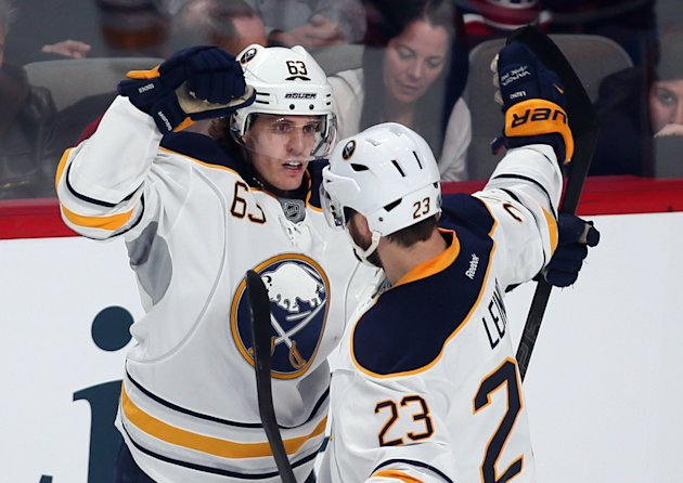 Buffalo Sabres Tyler Ennis and teammate Ville Leino  celebrate goal over Montreal Canadiens during first period NHL hockey action in Montreal