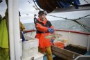 Skipper of the Whitby Rose, Howard Locker sorts his catch aboard his trawler in the North Sea
