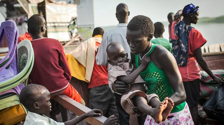 People fleeing violence in South Sudan's Bor region arrive on January 9, 2014 at Minkammen