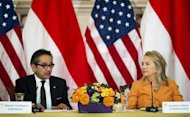 US Secretary of State Hillary Clinton hosts the third annual US-Indonesian Joint Commission meeting with Indonesian Foreign Minister R.M. Marty Natalegawa (L) at the US Department of State in Washington, DC
