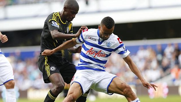 Jose Bosingwa (R) of Queens Park Rangers and Ramires of Chelsea fight for the ball