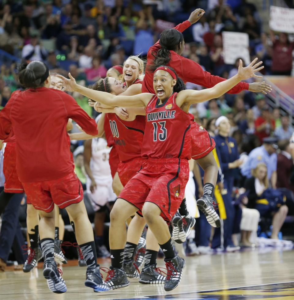Louisville players including Cortnee Walton (13) celebrate after a national semifinal against California at the Women's Final Four of the NCAA college basketball tournament, Sunday, April 7, 2013, in New Orleans. Louisville won 64-57. (AP Photo/Dave Martin)