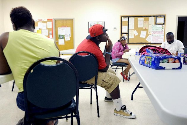 Deveon Brown (center) waits in a temporary shelter at the Boonsboro Volunteer Fire and Rescue Co. Inc. in Bedford County, Va., Friday June 29, 2012. Brown and other extended family members are visiting from Norfolk and have been staying at Eagle Eyrie nearby. A wave of violent storms sweeping through the mid-Atlantic following a day of record-setting heat in Washington, D.C., has knocked out power to nearly 2 million people. The storms converged Friday night on Washington, D.C., Maryland, Virginia and West Virginia. West Virginia Gov. Earl Ray Tomblin declared a state of emergency after more than 500,000 customers in 27 counties were left without electricity. (AP PHOTO/Photo by Parker Michels-Boyce, The News & Advance)