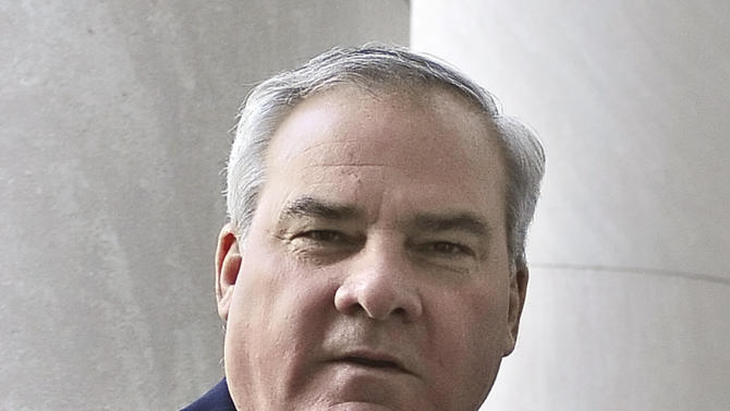 Former Connecticut Gov. John G. Rowland, right, arrives with his family at federal court Thursday, Sept. 18, 2014, in New Haven, Conn.  Rowland faces seven federal charges, including allegations he conspired with Apple's owner, Brian Foley, to hide $35,000 in payments for work he did on the 2012 congressional campaign of Foley's wife, Lisa Wilson-Foley. (AP Photo/Jessica Hill)