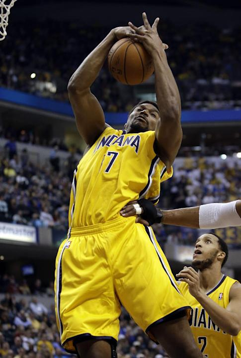 Indiana Pacers center Andrew Bynum (17) pulls down a rebound while playing the Boston Celtics during the first half of an NBA basketball game in Indianapolis, Tuesday, March 11, 2014