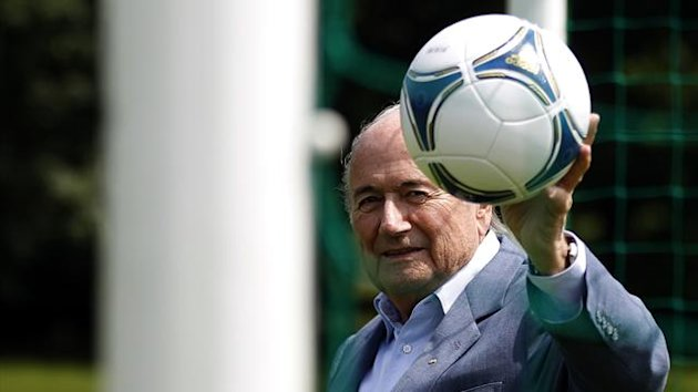 International Federation of Football Association (FIFA) President Sepp Blatter poses with a ball (Reuters)