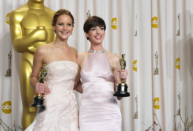 "Jennifer Lawrence, with her award for best actress in a leading role for ""Silver Linings Playbook,"" and Anne Hathaway with her award for best actress in a supporting role for ""Les Miserables,"" pose during the Oscars at the Dolby Theatre on Sunday Feb. 24, 2013, in Los Angeles. (Photo by John Shearer/Invision/AP)"