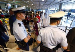 Police officers patrol at a security gate inside the main terminal of Frankfurt Airport