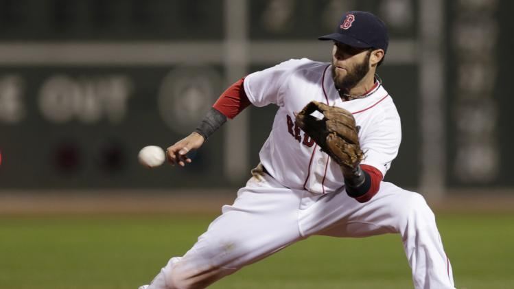 Boston Red Sox second baseman Dustin Pedroia fields a ground out by New York Yankees Brian Roberts during the fifth inning of a baseball game Thursday, April 24, 2014, in Boston. (AP Photo/Charles Krupa)