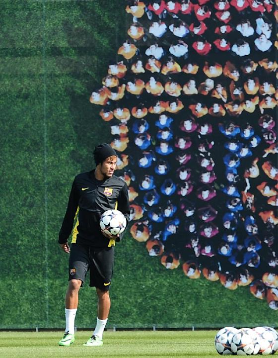 FC Barcelona's Neymar, from Brazil, holds the ball during a training session at the Sports Center FC Barcelona Joan Gamper in San Joan Despi, Spain, Tuesday, March 11, 2014. FC Barcelona will play