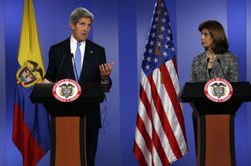 U.S. Secretary of State John Kerry, left, speaks as Colombia's Foreign Minister Maria Angela Holguin looks on during a joint news conference at the Presidential Palace in Bogota, Colombia, Monday, Aug. 12, 2013. Kerry is on a one-day official visit to Colombia. (AP Photo/Fernando Vergara)