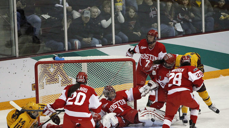 Boston goalie Kerrin Sperry (1) makes a save against Minnesota during the women's Frozen Four NCAA Championship college hockey game, Sunday, March 24, 2013, in Minneapolis. (AP Photo/Stacy Bengs)