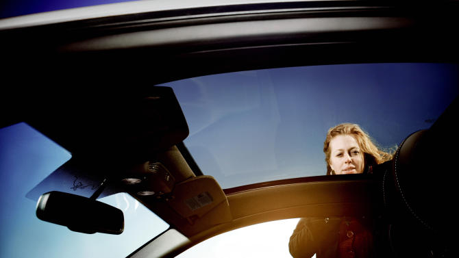 This undated publicity photo released by Ford shows a 2013 Ford Mustang with a laminated glass sunroof. To ensure a comfortable driving experience, the panoramic roof is made of tinted privacy glass which reduces both vehicle cool-down time and infrared energy. (AP Photo/Ford)