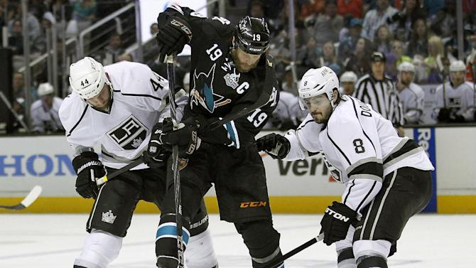 San Jose Sharks center Joe Thornton (19) battles for the puck against Los Angeles Kings defenseman Robyn Regehr (44), of Brazil, and Los Angeles Kings defenseman Drew Doughty (8) during the first period in Game 6 of their second-round NHL hockey Stanley Cup playoff series in San Jose, Calif., Sunday, May 26, 2013. (AP Photo/Tony Avelar)
