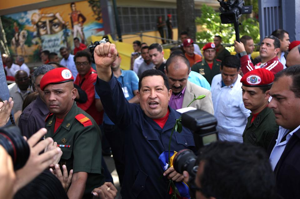 Venezuela's President Hugo Chavez arrives to a polling station during the presidential election in Caracas, Venezuela, Sunday, Oct. 7, 2012.  Chavez is running for re-election against opposition candidate Henrique Capriles.  (AP Photo/Rodrigo Abd)