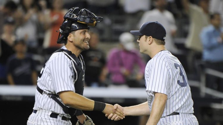 New York Yankees closer David Robertson, right, celebrates with catcher Francisco Cervelli after the Yankees defeated theToronto Blue Jays, 6-4 in a baseball game Friday, July 25, 2014, at Yankee Stadium in New York. (AP Photo/Bill Kostroun)