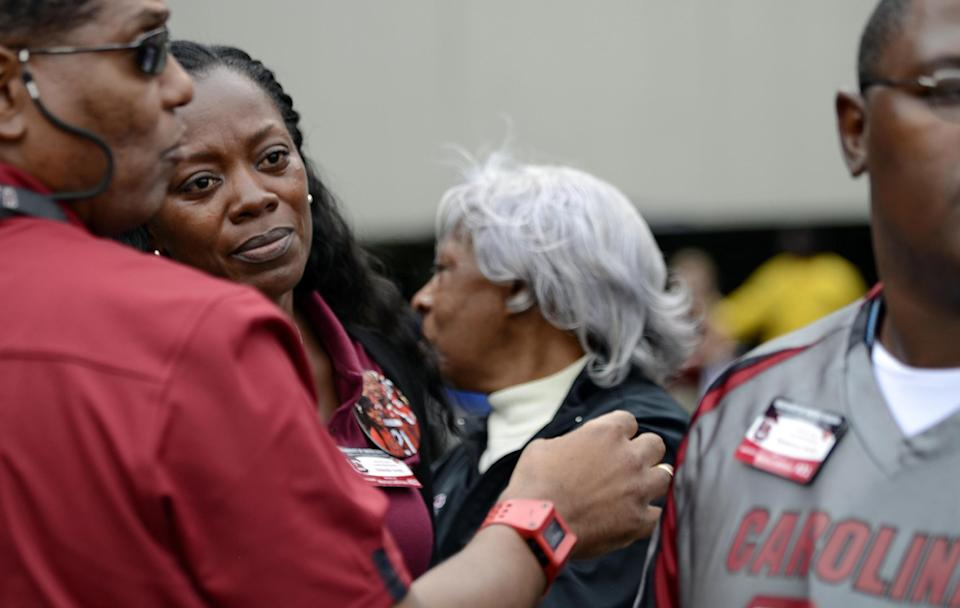 Yolanda Smith, second from left, the mother of South Carolina running back Marcus Lattimore watches from the sidelines after he was injured on a hit by Tennessee's Eric Gordon during the first half of an NCAA college football game, Saturday, Oct. 27, 2012 at Williams-Brice Stadium in Columbia, S.C.(AP Photo/Richard Shiro)