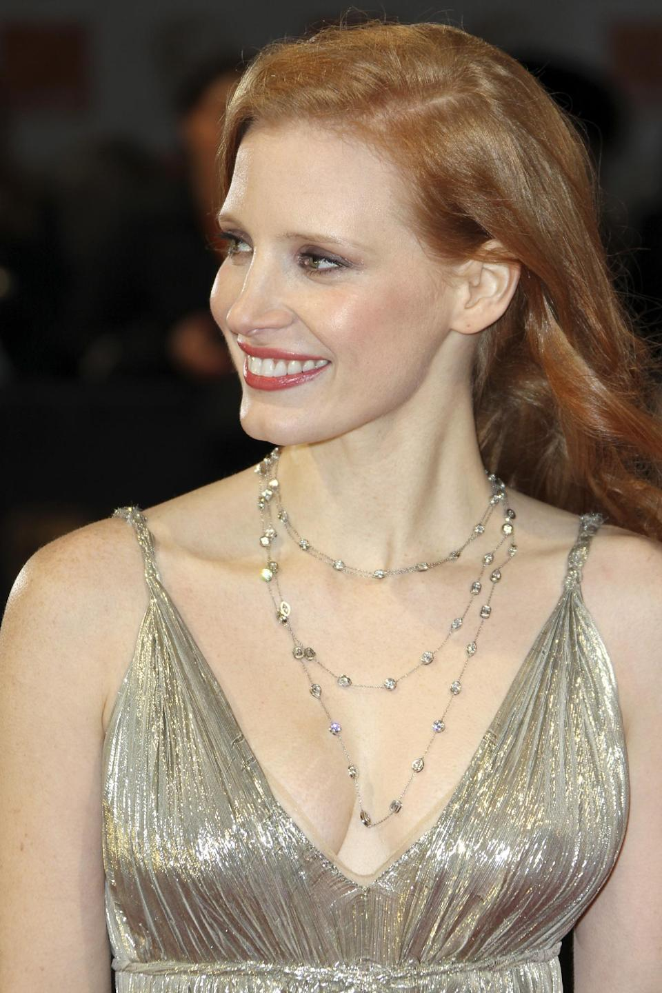 Actress Jessica Chastain arrives for the BAFTA Film Awards 2012, at The Royal Opera House in London, Sunday, Feb. 12, 2012. (AP Photo/Alastair Grant)