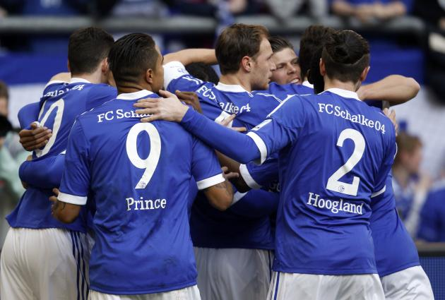 Schalke 04's players celebrate a goal against Hoffenheim during the German first division Bundesliga soccer match in Gelsenkirchen