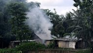 Rioters burn homes in Nelibari village in Assam state's Chirang District in July. Around 1,000 workers at the privately-owned M.K.B. Tea Estate attacked the plantation owner's bungalow on Wednesday and set it on fire in violence blamed on festering labour unrest in the tea-growing region, police said