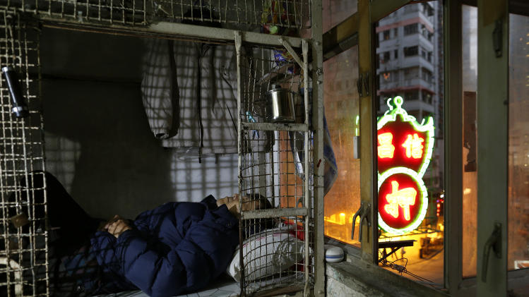In wealthy Hong Kong, poorest live in metal cages