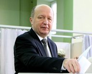 Lithuania's Prime Minister Andrius Kubilius casts his ballot at a polling station in Vilnius