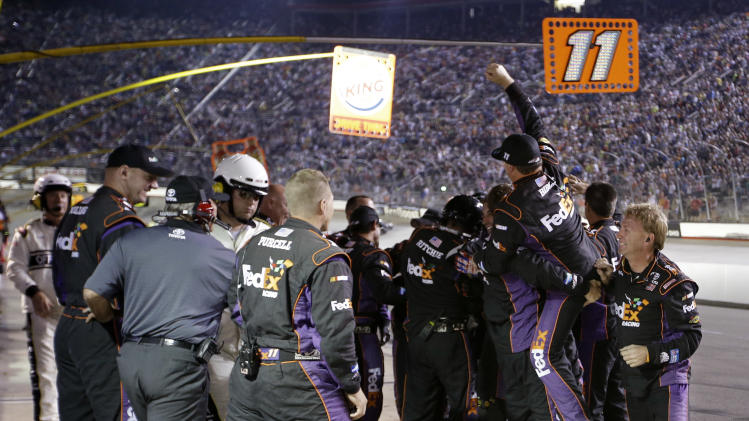 The pit crew of Denny Hamlin celebrates after Hamlin won the NASCAR Sprint Cup Series auto race on Saturday, Aug. 25, 2012, in Bristol, Tenn. (AP Photo/Mark Humphrey)
