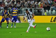 Juventus&#39; midfielder Arturo Vidal kicks a penalty during an Italian Serie A football match against Parma at the Juventus stadium in Turin. Juventus overcame a sluggish first-half display to kick off the defence of their Serie A crown with a 2-0 victory at home to Parma