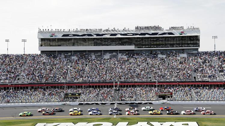 Danica Patrick, far left,  leads the group of race cars to start the Budweiser Duel 1 NASCAR Sprint Cup Series auto race at Daytona International Speedway, Thursday, Feb. 21, 2013, in Daytona Beach, Fla. (AP Photo/Chris O'Meara)