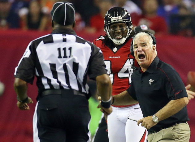 Atlanta Falcons head coach Mike Smith, right, argues for a pass interference call on a play involving wide receiver Roddy White, center, with an official during the second half of their NFL football game against the Denver Broncos, Monday, Sept. 17, 2012, in Atlanta. The Falcons won 27-21. (AP Photo/Atlanta Journal-Constitution, Curtis Compton) MARIETTA DAILY OUT; GWINNETT DAILY POST OUT; LOCAL TV OUT; WXIA-TV OUT; WGCL-TV OUT