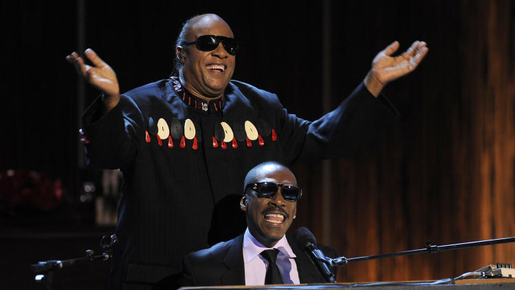 "Eddie Murphy, bottom, and Stevie Wonder perform Wonder's song ""Higher Ground"" onstage during ""Eddie Murphy: One Night Only,"" a celebration of Murphy's career at the Saban Theater on Saturday, Nov. 3, 2012, in Beverly Hills, Calif. (Photo by Chris Pizzello/Invision)"