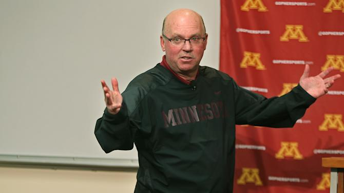 "The University of Minnesota football coach Jerry Kill speaks to the media during a news conference on campus regarding his raise, and spring football, Monday, Feb. 24, 2014 in Minneapolis, Minn. Kill says he's ""getting paid way too much"" to be Minnesota's coach but appreciative of the raise and contract extension he received"