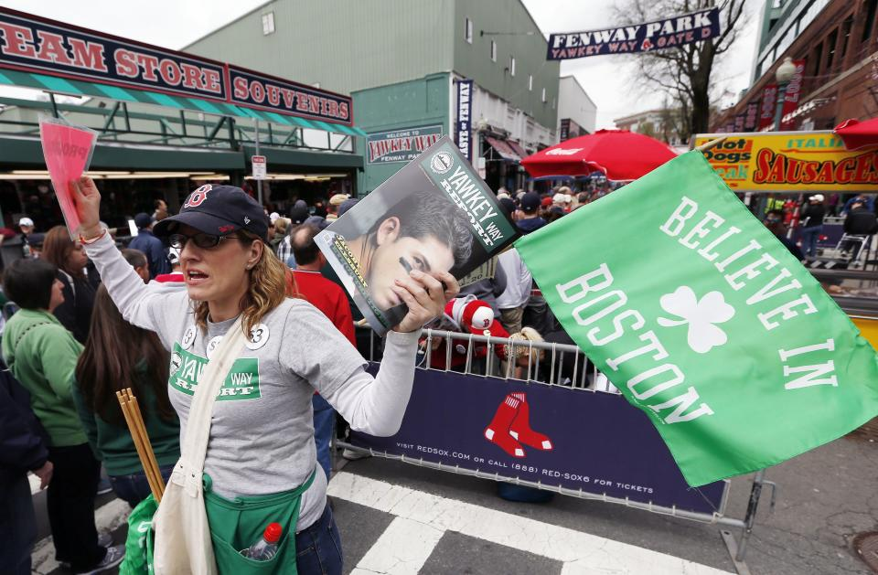 A vendor stands sells souvenirs outside Fenway Park before a baseball game between the Boston Red Sox and the Kansas City Royals in Boston, Saturday, April 20, 2013. (AP Photo/Michael Dwyer)